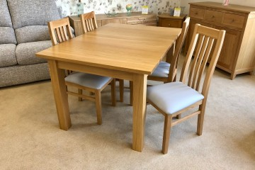 - Nimbus Extending Dining Table and 4 Calder Dining Chairs